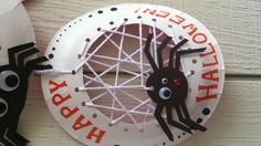 Halloween crafts for kids, paper plate and string spider web.  Introduction to needlecraft and could be used for science cross subject learning.