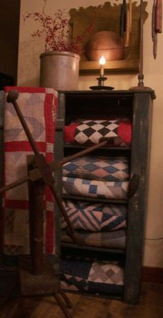 Prim Cupboard...with old quilts.