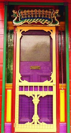 Colorful doorway, Melbourne, Australia. [My eagle eye spies what looks like a Balinese naga (dragon) and dancers above the door. ~ Indounik]