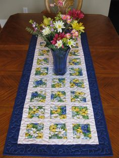 Daises Quilted Table Runner (Will put this idea on my list of pieces to do - I like the daisy idea but I might go with more greens)