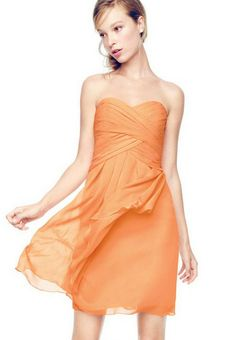 "On trend and ultra feminine, this strapless bridesmaid dress is one that your girls will wear long after you've said ""I Do."" Ruching detail shapes a stunning sweetheart neckline, while crinkle chiffon flows to create a cascading front that adds dimension and romance. David's Bridal Bridesmaid Dress Style F14847. Pictured in Tangerine, but available in all David's Bridal colors."