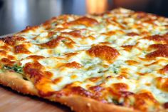 cheese and pesto pizza.