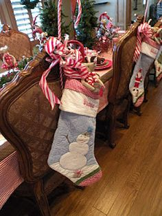 Hang stockings on back of chairs