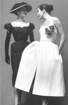Simple, elegant and still a modern as the day it was made. The Wedding Dresses timeless look is a contrast to the classic look of the era seen in the Mother of the Bride outfit. Christian Dior, 1951  Photo by Gordan Parks