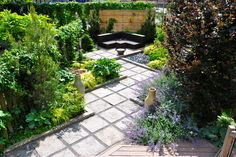 """This typical, square, flat backyard was transformed into several garden """"rooms"""" - stepping stones with gravel add textural interest, and are much more affordable (and an easy DIY project) than poured concrete..."""