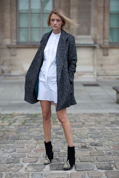 STREET STYLE SPRING 2013: PARIS FASHION WEEK - A crisp white dress gets the fall treatment in Balmain booties and a proper coat.