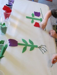 from teach preschool, use clear contact paper, sticky side up and packing tape to anchor.  Put supplies in cups and let the chilren explore.  Use with gail Gibbons and Eric Carles books about seeds science table preschool, preschool flower craft, flowers preschool activities, contact paper, planting preschool, preschool seeds, science plants preschool, preschool flowers, kid