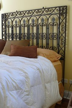 repurposing victorian era cast iron fence as headborards. Love!