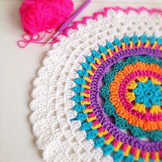 Crochet mandala. No pattern or tutorial, but an experienced crafter could reproduce this mandala from a close examination of the picture. Beautiful yarn, too!