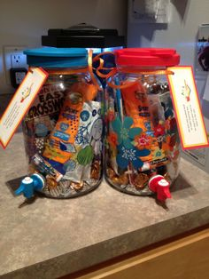 """Teacher gift for preschool teachers--Tea dispenser filled with Hershey's hugs and kisses, sun screen, SPF lip balm, crossword puzzle book, crystal light and ice tea mixes. Tag says """"All year you worked hard to make learning fun. So now it's your turn to relax in the sun"""""""