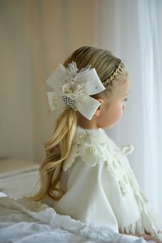 French braid in front makes this little girl's curly ponytail more elegant