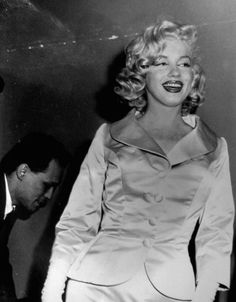 January 28, 1958: Marilyn Monroe wears a silk and satin jacket and skirt that is champagne coloured, that was designed by John Moore Talmack. Participants in the show consisted of members of the high fashion of New York Institute Gress, and designers of California, New York and Italy.