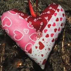 Patchwork Hanging Hearts - These Patchwork Hanging Hearts are some of the easiest Valentine's Day decorations out there.