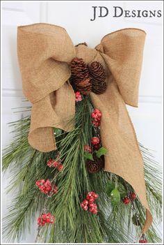 JD Designs - Realistic looking cedar and pine cone swag.