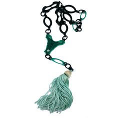 """Black and Jade celluloid flapper necklace from the 1920s France. Butterfly motif pendant teriminating in a pale jade silk tassel.    Necklace (black chain)28"""",plus butterfly motif 2.75"""", plus tassel 10.75"""""""
