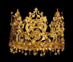 folding gold crown from one of the six graves of Bactrian nomads  discovered at Tillya Tepe in northern Afghanistan in 1978. The crown,  dating from the first century A.D. and wrought of solid gold, was  collapsible for easy transport by the ancient nomads.