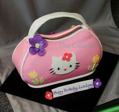 Hello Kitty purse cake by TheCakeLife