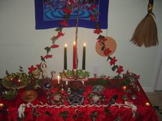 Yule - my great grandmother actually hand made that porcelain Yule-log candle holder :) Decor includes mistletoe (shot down by my awesome father-in-law), holly leaves and berries, juniper sprigs, and anything naturally in my yard that was still vivid green mid-December. #wiccan #pagan