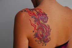Love this dragon tattoo. Artist Saigh