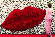 A total of 200,000 stems of red and white roses, shipped in from Colombia and Ecuador, decorated the met. museum gala. A team of 150 staffers worked to prepare the floral decor.