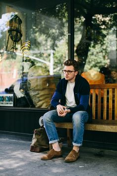 Style for men, blue color block cardigan worn with denim and neutrals
