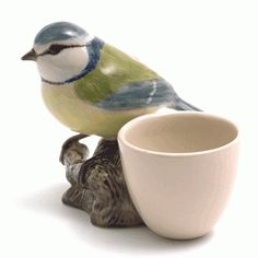Well OF COURSE an egg cup should have a little bird perched beside it. Especially a speices who name will make anyone titter over their easy-over. The Victoria & Albert Museum home collection.