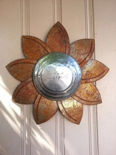 Ford hubcap flower rusted metal wall hanger by MyRustedRoots, $79.00