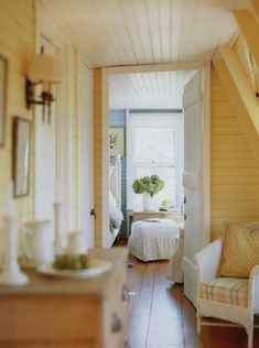 love the yellow wood walls, farmhouse style door, wood ceiling, everything