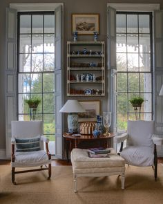 Elegant floor to ceiling shuttered windows in a restrained palette traditional room ~ Furlow Gatewood