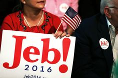 A woman holds a Jeb!