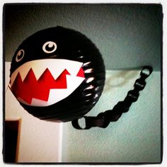 Mario Party decorations - spray paint a paper lantern for Chain Chomp