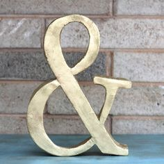 You will not believe what this ampersand is made out of.  Come get step by step instructions on how you can make this too.