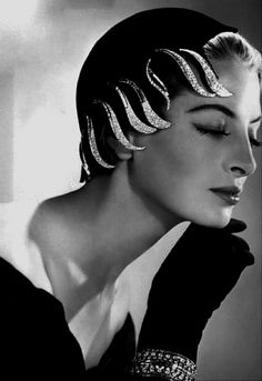 Actress Capucine wearing a hat by Jean Barthet, 1954