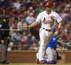 Matt Carpenter tosses his bat after being walked in the fourth inning of a game against the Chicago Cubs. Cards won 4-3 in the 12th. 5-13-14