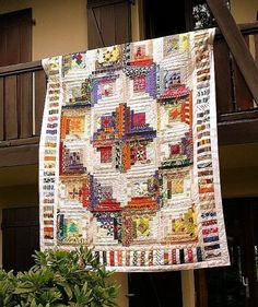 Beautiful log cabin quilt setting