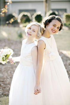 sleeveless flower girl dresses, photo by Tiffany Hughes Photography http://ruffledblog.com/1950s-inspired-auburn-wedding #flowergirls #wedding