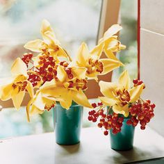 Love this color combo...of v is up for some yellow in the mix. Casual  Bright, cheerful red berries bring orchids down to earth. One stalk of the orchid cut in two (with a few blossoms plucked off) yields several small bouquets when paired with some contrasting viburnum fruit.