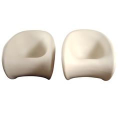 A pair of fibre rocking chairs