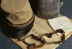 Personal items of General Stonewall Jackson include an old high-topped forage cap, spurs which were on his boots when he was fatally wounded and the cloth showing blood from his wound. (Photo Credit: Tria Giovan/CORBIS)