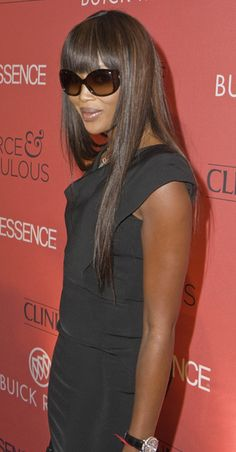 Naomi Campbells long, wavy hairstyle