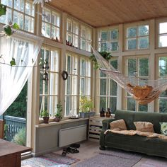 living room/ sun room, love the windows and wood ceiling