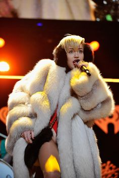 Baby, it's cold outside. #MileyCyrus keeps warm during a performance at Power 96.1-FM's Jingle Ball 2013 on Dec. 11 at #PhillipsArena in Atlanta