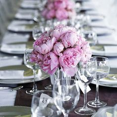 Wedding Centerpiece Idea: Chocolate Brown and Pink. Narrow Tuscan-style tables arranged in a U-shape displayed the wedding color combination -- chocolate brown (in the linen runner), pink (in the peony arrangements), and chartreuse (in the menus tucked into the folds of the napkins).