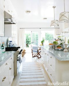 A traditional white-on-white kitchen with an East Coast–flavored bead board.