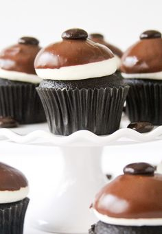Junior Mint Cupcakes -- mint chocolate cupcakes, creamy mint frosting, soft chocolate shell.