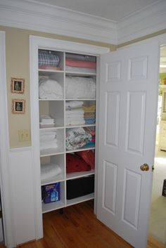 great way to turn a small closet into a linen closet!
