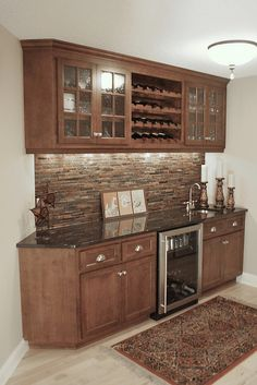 Bar Area.  This is perfect for downstairs.  Doesn't require a lot of room yet has everything you need.  Small sink, wine chiller/storage and a few few cabinets.  All it's missing is a mini fridge!