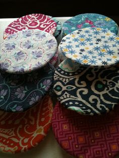 Circle Quilt Tutorial.  I love this fabric--I bought 3 charm packs and some yardage at a little quilt shop.  FUN!