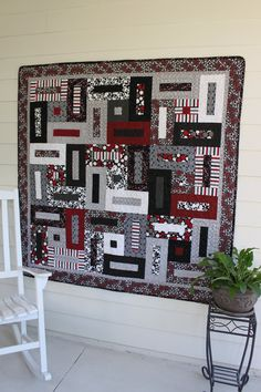 Black, Gray, Red, and White Keyholes Quilt.