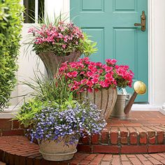 Romantic Stair Step Pots | 'Caliente Pink' geraniums, 'Surfinia Rose Veined' petunias, and 'Techno Heat Light Blue' lobelias create a soft and feminine color palette for this doorstep welcome. | SouthernLiving.com color palettes, stair container gardening, door colors, petunia, paint colors, stair step